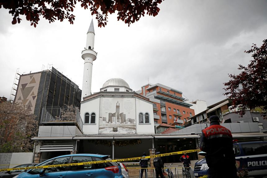 Albanian police officers secure the area near Dine Hoxha mosque after a knife attack in Tirana, Albania, April 19, 2021.
