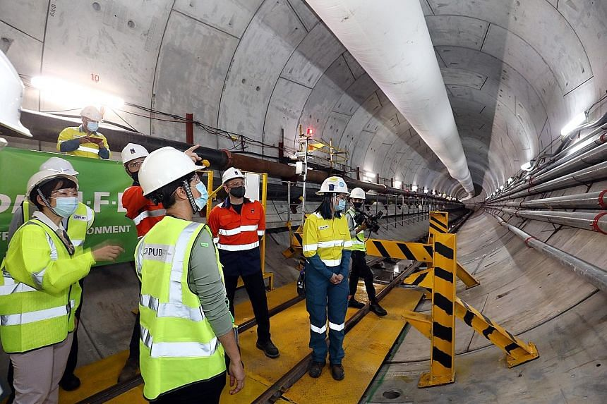 Second Minister for Finance Indranee Rajah (far left) at a site in the Penjuru Road area for phase two of the Deep Tunnel Sewerage System project. About 24km of the 100km-long conveyance system for this phase has been completed.