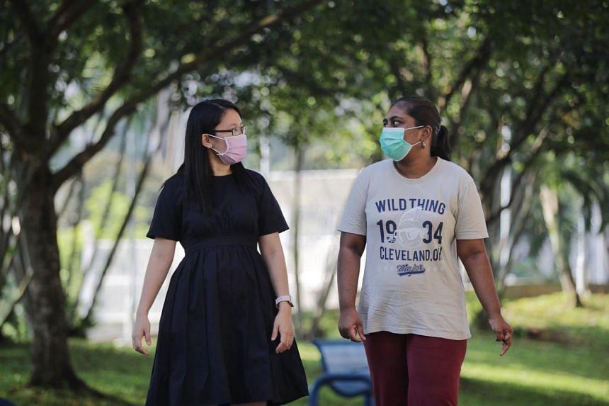 Senior social worker Tay Yu Ping (left) with Ms Shantini Murugiah at Limbang Park during a community walk on April 20, 2021.