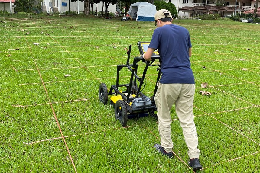 A ground-penetrating radar device being used at a football field at Alexandra Hospital as part of the survey. The 6,000 sq m field is believed to be the site of a mass grave of victims who died during World War II.