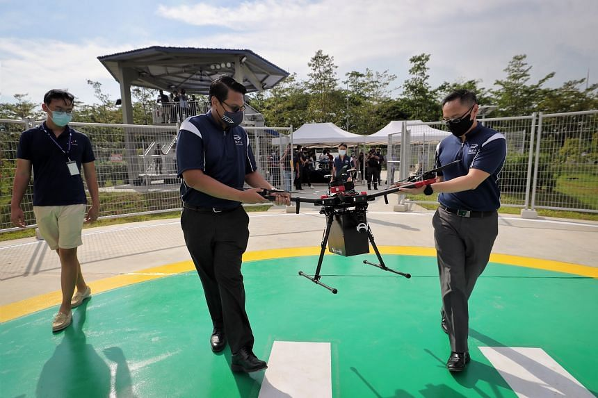 A drone being prepared to deliver a package to a ship anchored in Singapore's Maritime Drone Estate on April 20, 2021.