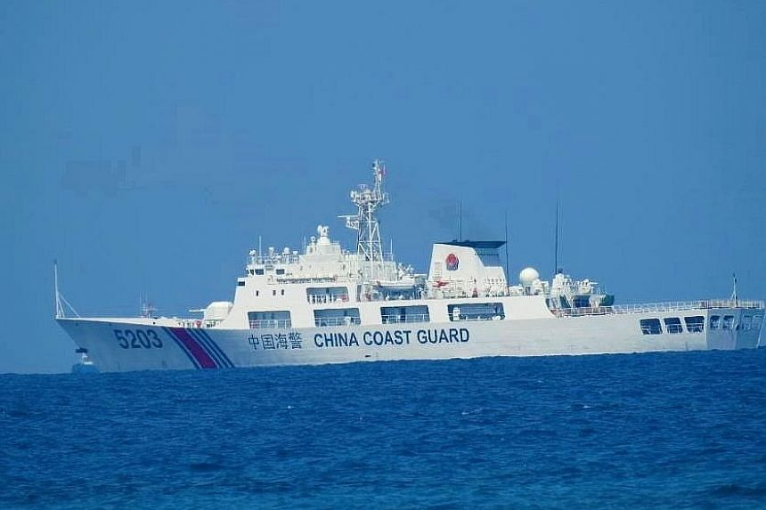 A China Coast Guard patrol ship seen in the South China Sea last week, in a photo distributed by the Philippine Coast Guard. Beijing claims nearly all of the sea but there are competing claims from Brunei, Malaysia, the Philippines and Vietnam.