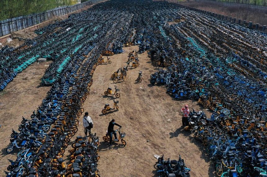 Aerial photographs from the suburbs of Shenyang show a bicycle graveyard.