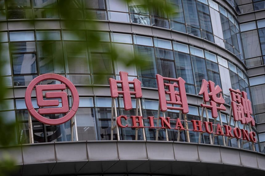 China Huarong International Holdings' dollar bonds jumped early on Wednesday before pulling back.