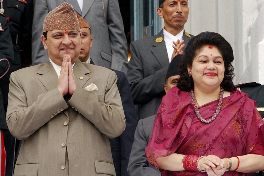 In this photo taken on Sept 6, 2006, the then Nepal's King Gyanendra and Queen Komal watch a chariot procession during the Indra Jatra Festival in Kathmandu.