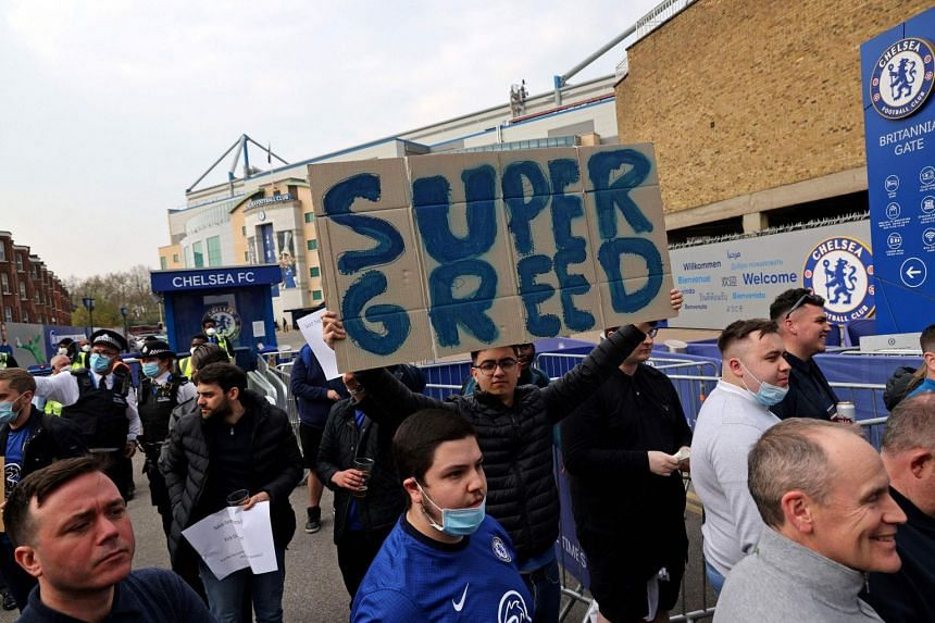 Football fans demonstrate against the proposed European Super League outside of Stamford Bridge football stadium, on April 20, 2021.