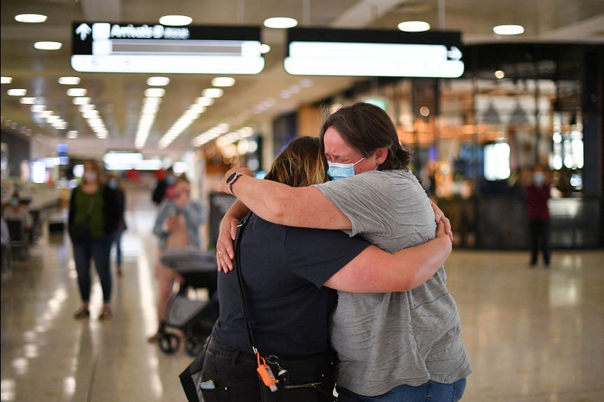A mother embraces her daughter upon her arrival from New Zealand at Sydney International Airport, on April 19, 2021.