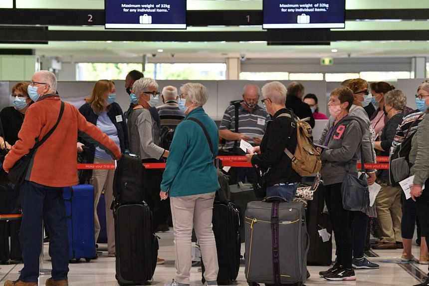 Passengers at check-in counters for New Zealand flights at Sydney International Airport on April 19, 2021.