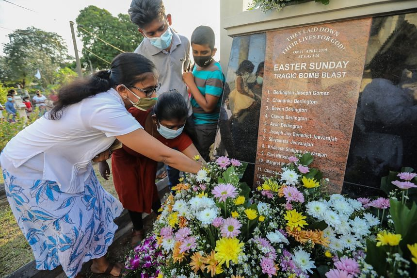 Relatives of the victims of the Easter Sunday bomb attacks laying tributes at the monument in memory of those who died, in Colombo, Sri Lanka, on April 18, 2021.