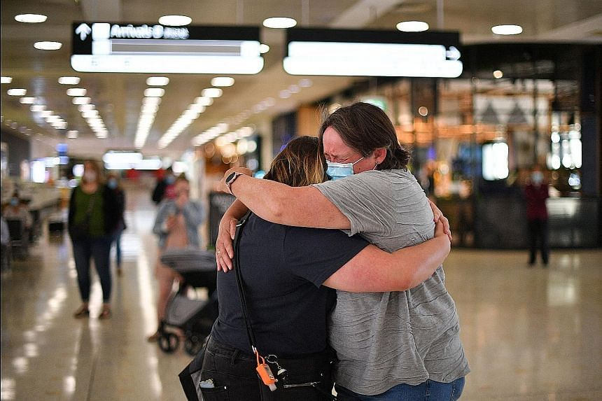 A mother (right) embracing her daughter upon her arrival from New Zealand at Sydney Airport on Monday, after Australia and New Zealand opened a quarantine-free travel bubble. Both nations are largely free of community-transmitted Covid-19 cases.