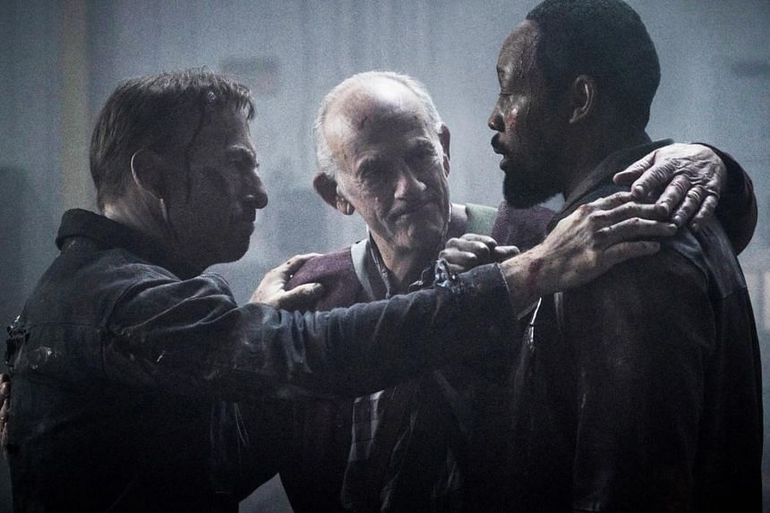 A still from film Nobody starring (from left) Bob Odenkirk, Christopher Lloyd, and RZA.