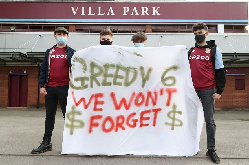 Fans display a banner reacting to the collapse of the planned Super League ahead of a Premier League match between Aston Villa and Manchester City at Villa Park on April 21, 2021.