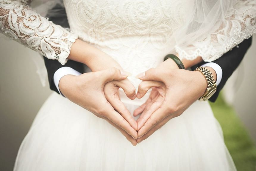 In 2019, 1,727 Singaporean women wed non-resident grooms - 75 per cent more than the 989 in 2000.