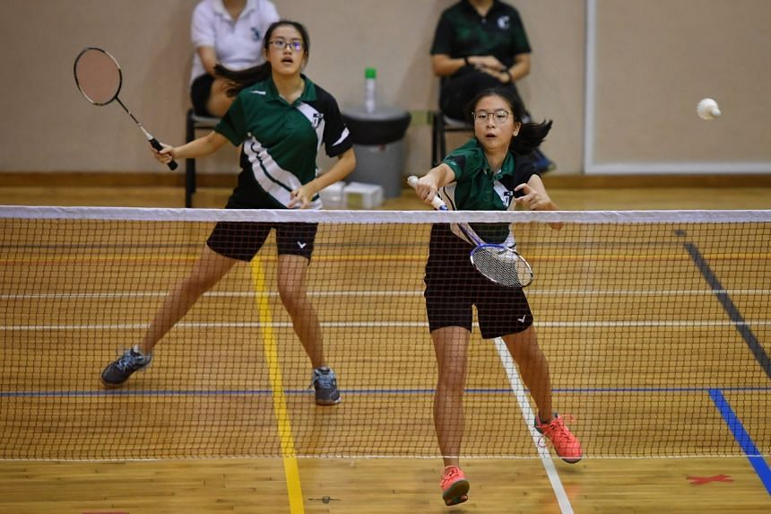 (From left) Ashlyn Chua and Zion Seng from Raffles Girls' School in action during the Badminton B Div girls' South Zone final on April 22, 2021.