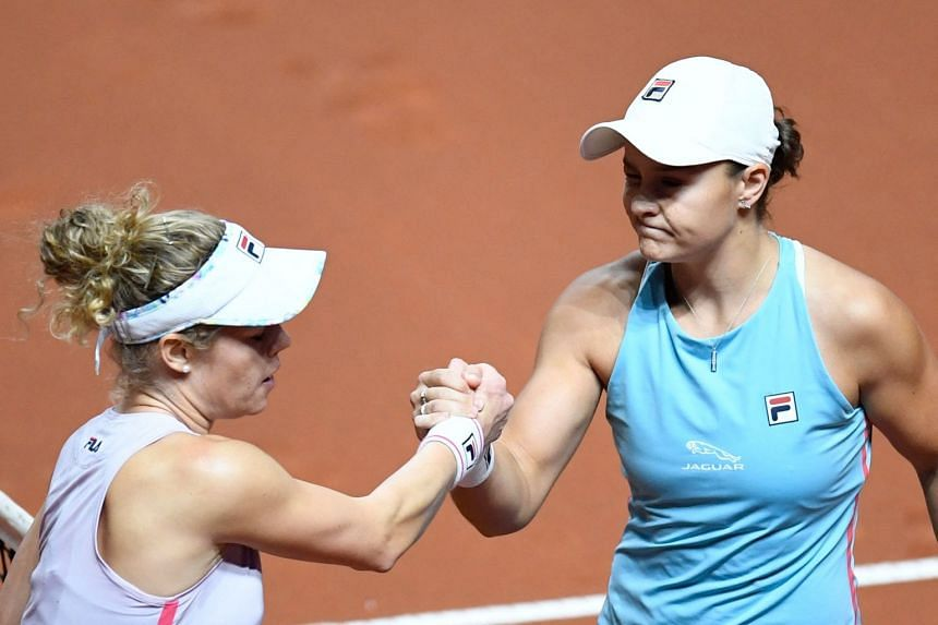 Australia's Ashleigh Barty (right) and Germany's Laura Siegemund shake hands after the match.