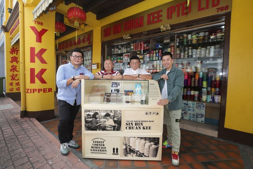 (From left) Mr Adrian Ng Chuan Aun with his uncle, Mr Ng Cheow Kok, his father, Mr Ng Cheow Poh, and his brother, Mr Kenny Ng Kian Aun, outside Sin Hin Chuan Kee.