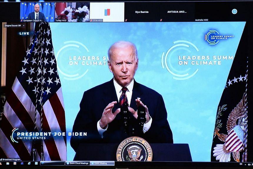 US President Joe Biden is seen on screen as European Council President Charles Michel attends a virtual US global climate summit, in Brussels, Belgium.