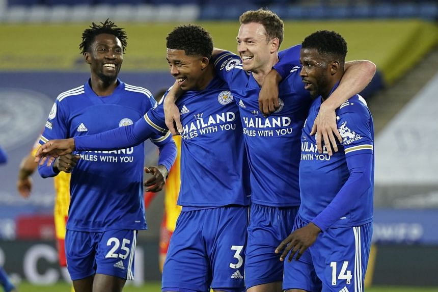 Leicester's Jonny Evans (second right) celebrates with teammates after scoring his side's second goal.
