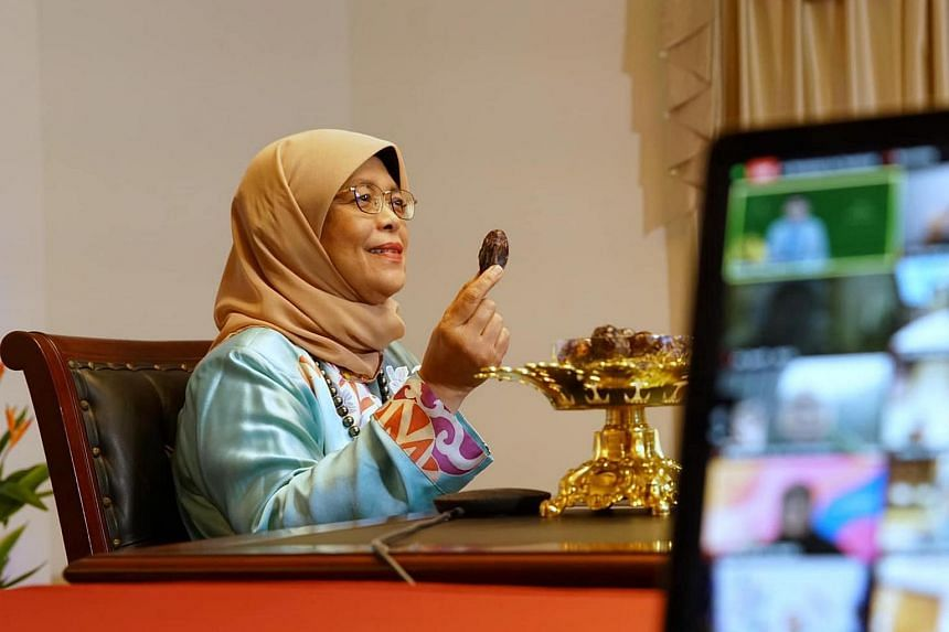 President Halimah Yacob breaking fast with others at the virtual Muis Buka Puasa on April 23, 2021.