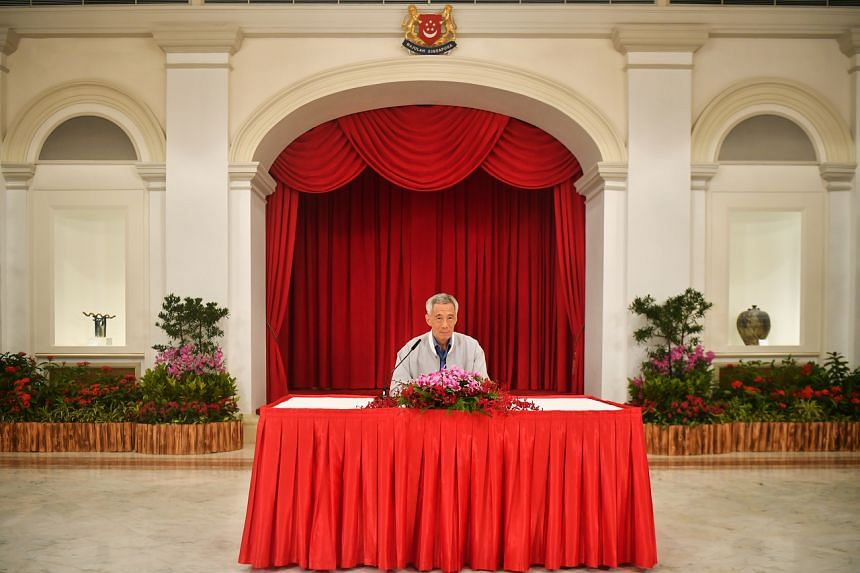Prime Minister Lee Hsien Loong announcing a reshuffle of his Cabinet at the Istana on April 23, 2021.