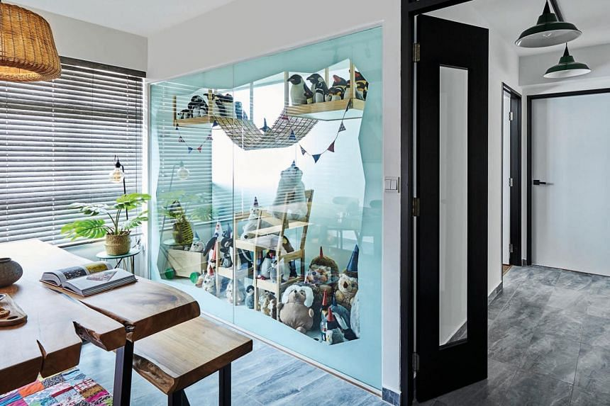 The heart of the home is a glazed display window which showcases a collection of plushies.