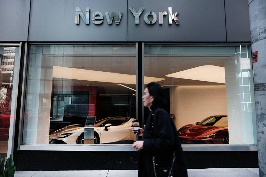 People walk by a Ferrari dealership in Manhattan on April 06, 2021 in New York City.