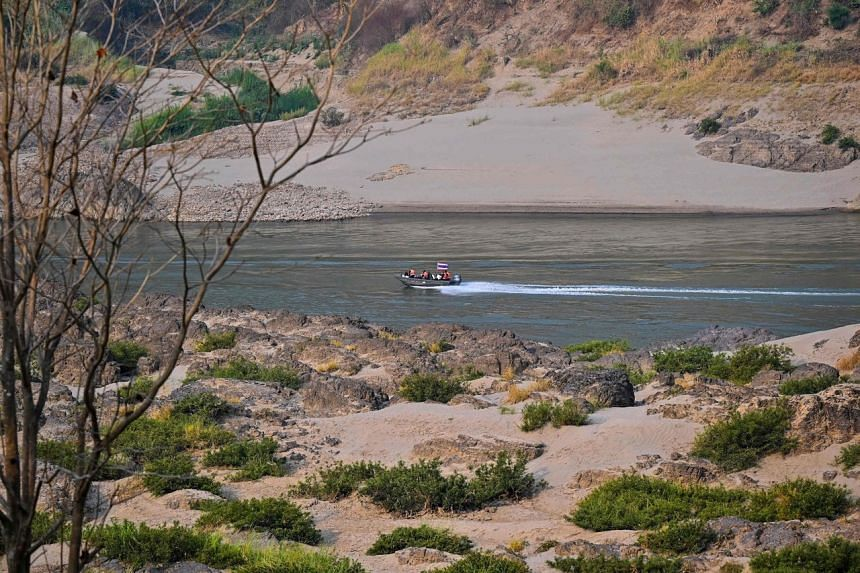 A restaurant owner in the area said the shots were fired into the water beside the boat on the Salween river (pictured).