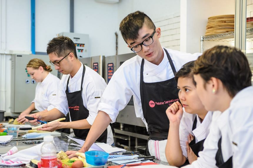 A file photo shows an in-person cooking class at Palate Sensations Culinary School.