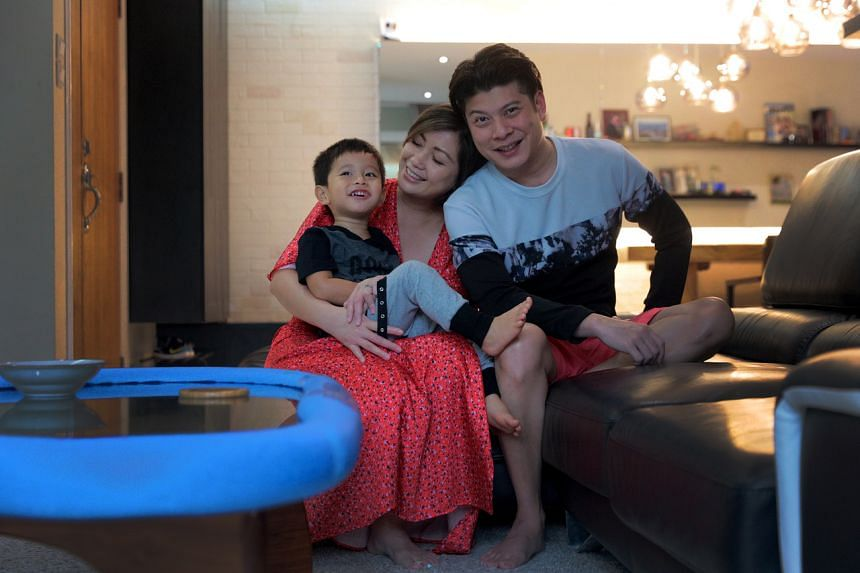 One FM 91.3 radio presenter Tim Oh with his wife Sabrina Chua and son Charlie.