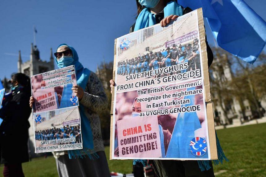 Members of the Uighur community demonstrating in London on April 22, 2021.