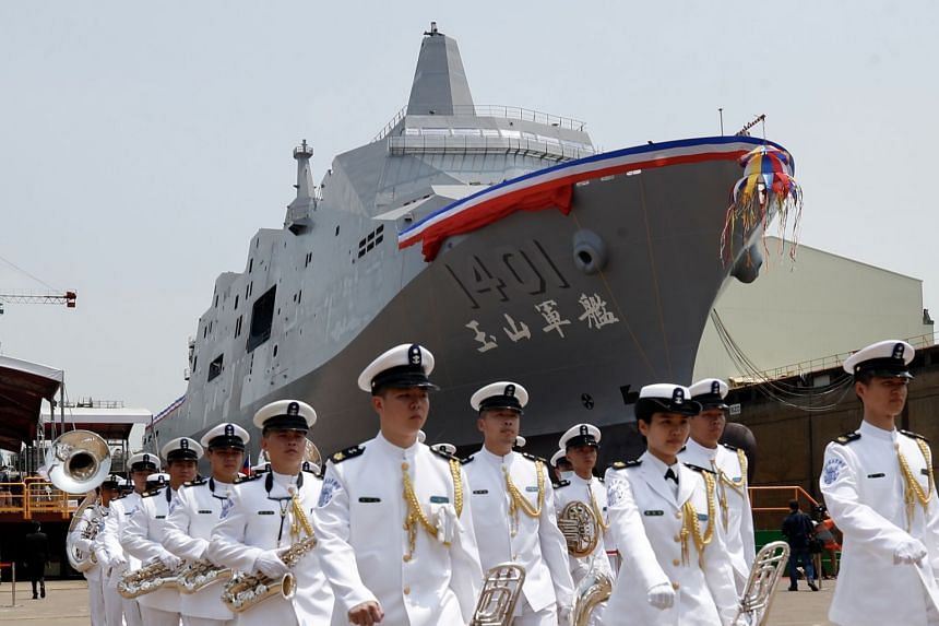 Members of an honour guard at the launch of Taiwan's new amphibious transport dock, named Yu Shan, in Kaohsiung last week.