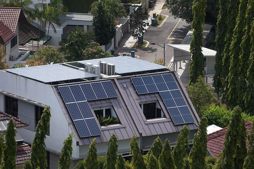 The writer says rooftop solar panels may worsen the heat island effect and increase air-conditioner use because the roof will be very hot. This may result in higher energy costs instead.