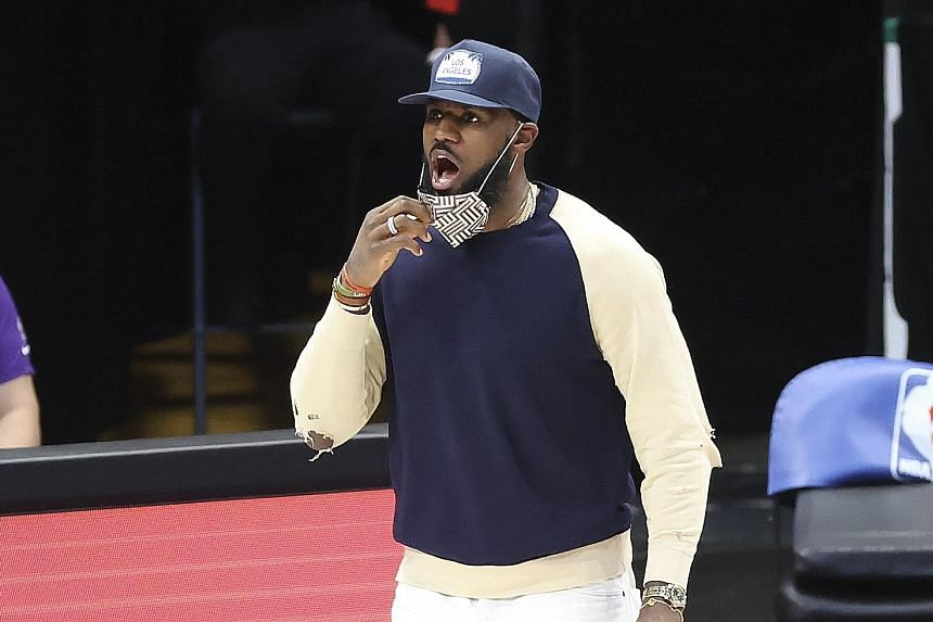 Lakers forward LeBron James, who is injured, yelling during the game against the Dallas Mavericks, who won 115-110 on Thursday.