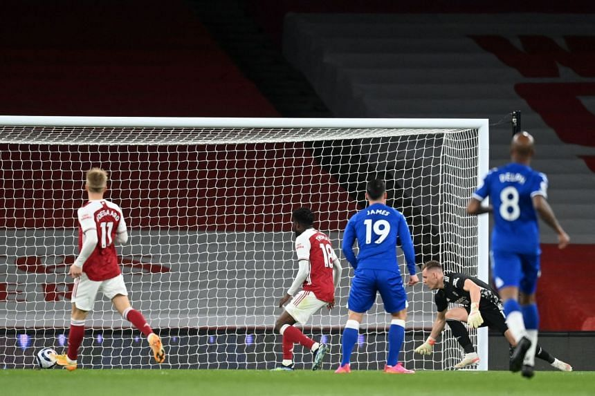 Arsenal's Bernd Leno (second right) watches after deflecting the ball into his own het for an own-goal.