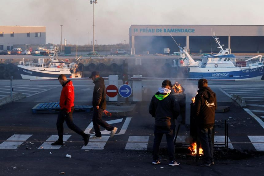 French fishermen blocking lorries carrying UK-landed fish at the fishing port in Boulogne-sur-Mer on April 23, 2021.