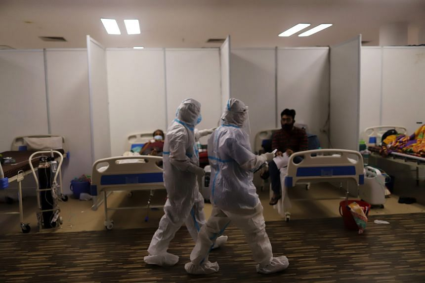 Health workers and patients in a Covid-19 hospital set up inside a stadium in New Delhi on April 23, 2021.