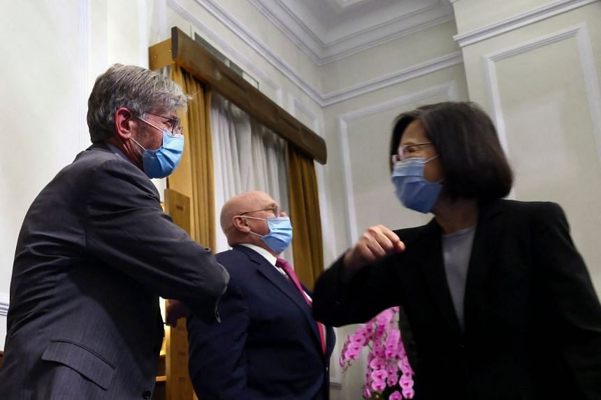 Taiwan President Tsai Ing-wen (right) greeting former US deputy secretary of state James Steinberg, with fellow envoy Richard Armitage (centre), at a meeting in Taipei last week.