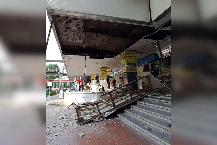 A large section of ceiling boards affixed to a wooden frame and other debris were seen strewn across a section of the stairs near the taxi stand.