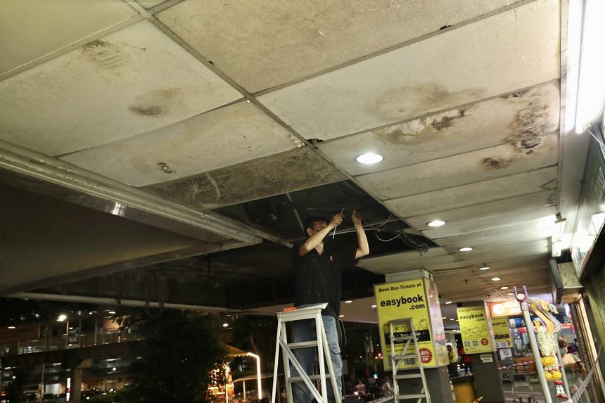 Workers were also seen examining the part of the ceiling from where the boards had fallen.