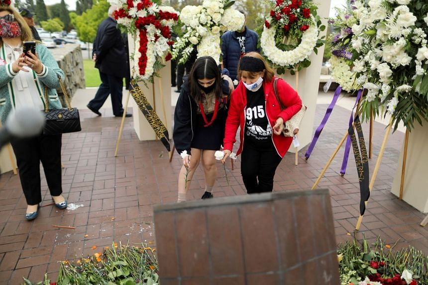 Members of the Armenian diaspora in the US place flowers as they gather in remembrance of the 1915 genocide, in Montebello, California, on April 24, 2021.