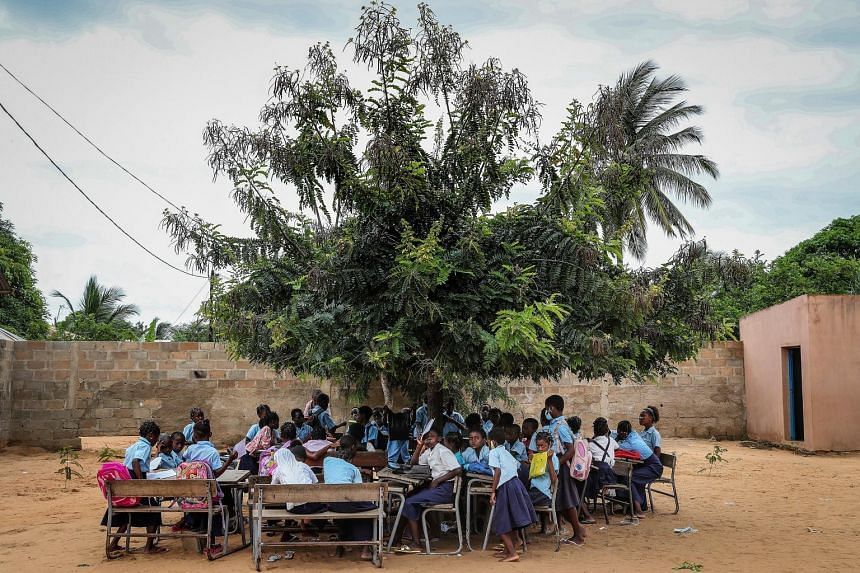 An open-air class at a school in Mozambique. The country is among dozens of nations at the crossroads of two mounting global crises that are drawing the attention of world financial institutions: climate change and debt.