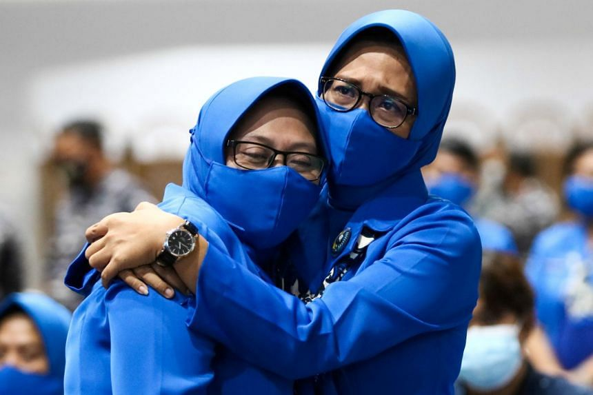The family of the sunken KRI Nanggala-402 submarine crew members at Koarmada II fleet office in Surabaya, on April 25, 2021.