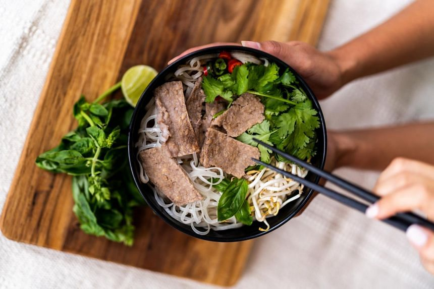 Gaia Foods' first structured beef prototype, served with rice noodles.