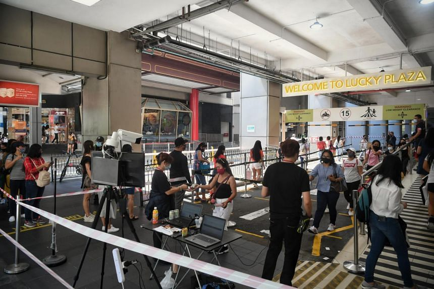People queueing at the side entrance of Lucky Plaza on April 25, 2021.