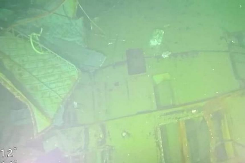 An image from the camera of the MV Swift Rescue vessel, captured at a depth of 838m, showing hull parts from the sunken submarine.
