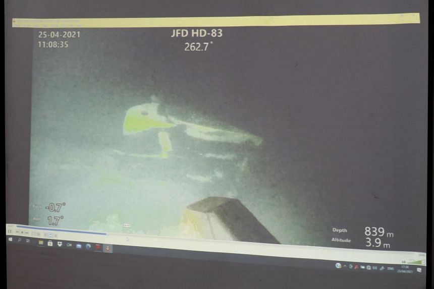 Parts of the missing submarine have been found cracked apart on the seafloor in waters off Bali.