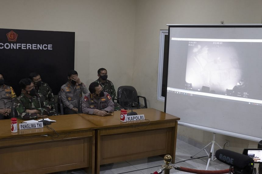 A military officer shows a video of the sunk Indonesian Navy submarine KRI Nanggala during a press conference on April 25, 2021.