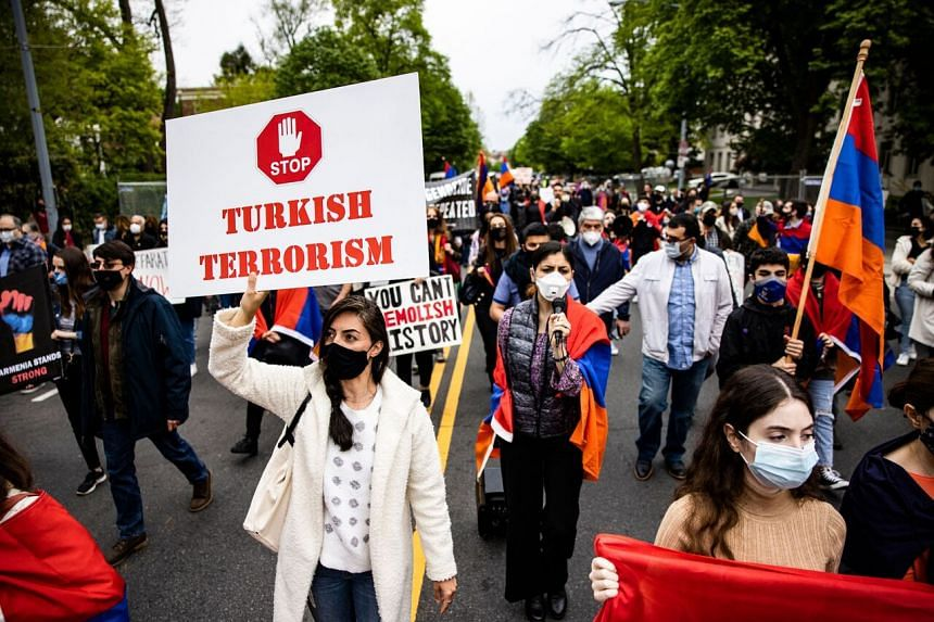 Armenians march towards the Turkish embassy during a protest in Washington, DC, on April 24, 2021.