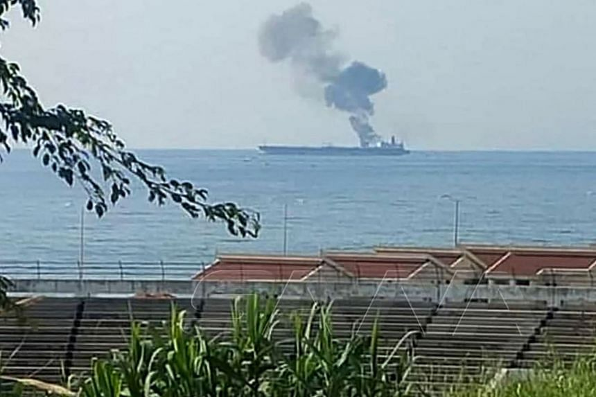 A handout picture released by the official Syrian Arab News Agency on April 24, 2021, shows smoke billowing from a tanker off the coast of the Syrian town of Baniyas.