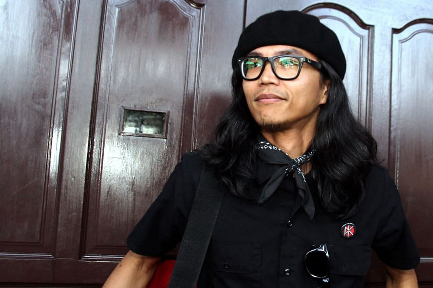 Mr Fahmi Reza (above), a Malaysian graphic artist, was detained by police for allegedly insulting Malaysia's Queen, Tunku Azizah Aminah Maimunah Iskandariah, by making a Spotify playlist that mocked a comment on the Queen's Instagram account. PHOTO: